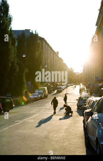 Sweden, Stockholm, street brightly illuminated at sunset - Stock Image