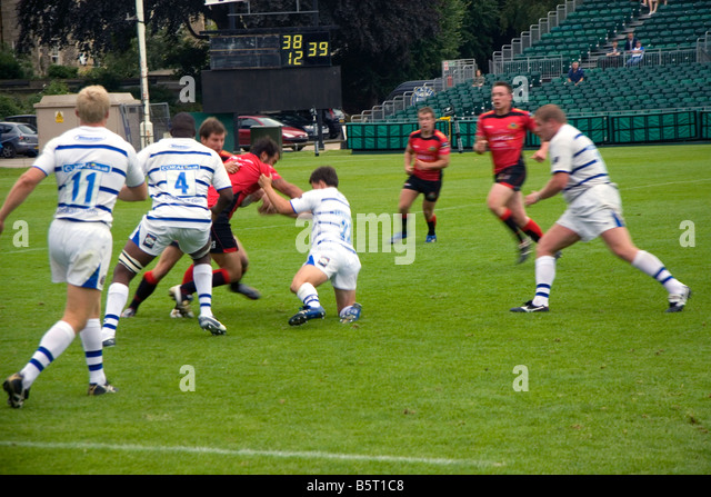 Men play a game of rugby in the city of Bath Somerset England - Stock Image