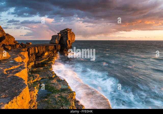 Portland Bill, Dorset, UK. 26th April 2016.  UK Weather - Stormy looking clouds  above Pulpit Rock at Portland Bill - Stock Image