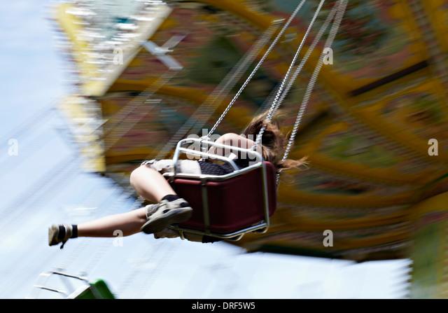 Girl  Sitting On Amusement Park Ride, Bad Woerishofen, Bavaria, Germany, Europe - Stock-Bilder