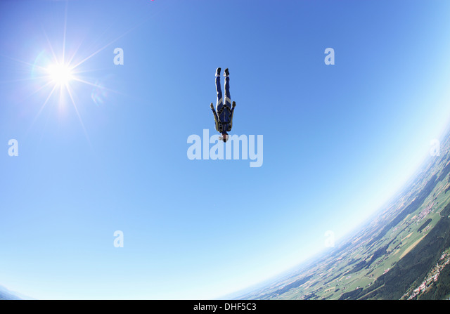 Female skydiver free falling head first above Leutkirch, Bavaria, Germany - Stock-Bilder