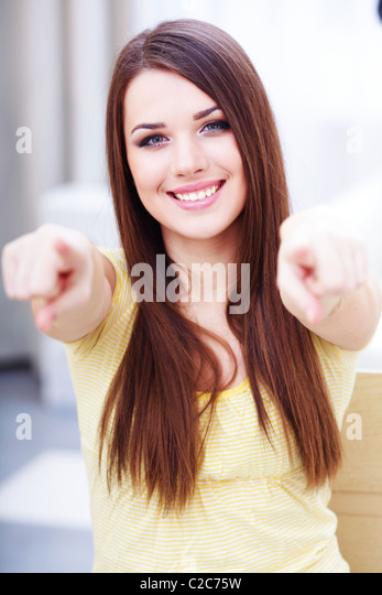 Portrait of a young beautiful casual woman pointing at you - Stock Image
