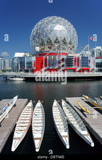 Science World or Telus World of Science and dragon boats moored at False Creek in Vancouver, BC, Canada - Stock-Bilder