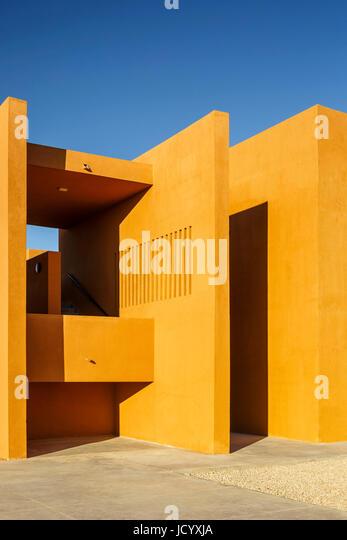 Sunlit exterior facade. Laayoune Technology School, Laayoune, Morocco. Architect: Saad El Kabbaj, Driss Kettani, - Stock-Bilder