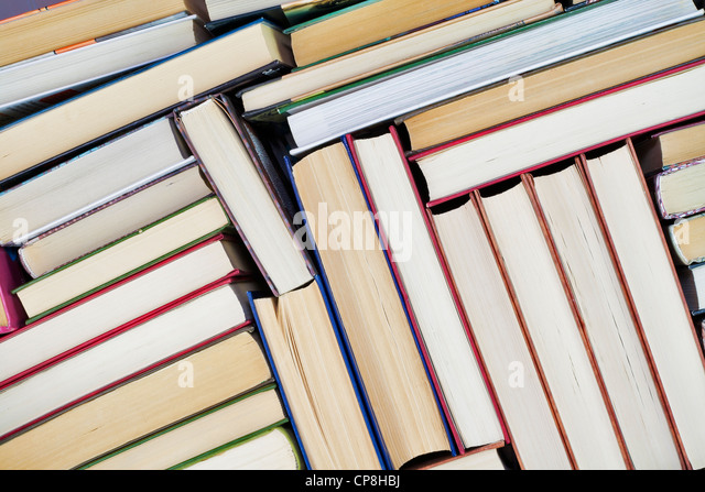 Old books on Book shelf background - Stock Image