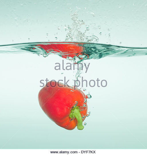 Bell pepper splashing in water - Stock Image