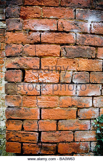 A  damaged  brick wall - Stock Image