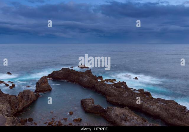 Lava Rock Coast at Dawn at Charco del Viento, La Guancha, Tenerife, Canary Islands, Spain - Stock Image