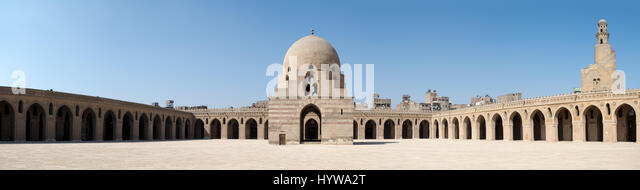 Panorama of the courtyard of Ibn Tulun Mosque, Cairo, Egypt, featuring the ablution fountain and the minaret. The - Stock Image