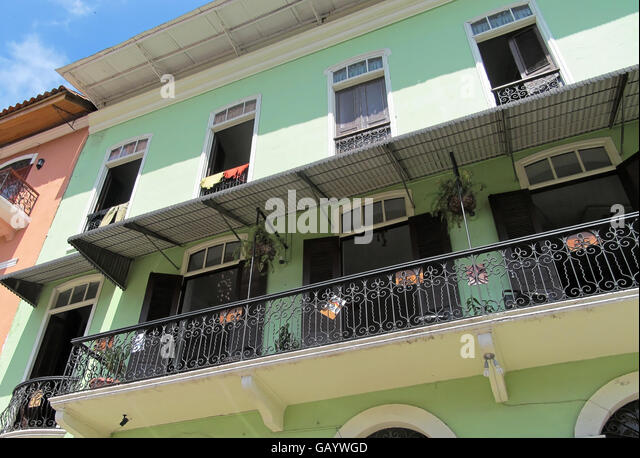Pastel green and black preserved and refurbished building featuring old classic architecture in Casco Viejo, Panama. - Stock Image