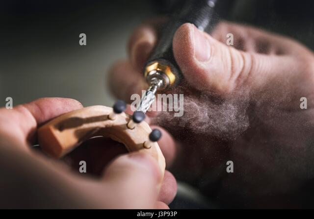 Person making prosthetic teeth, close up. - Stock-Bilder