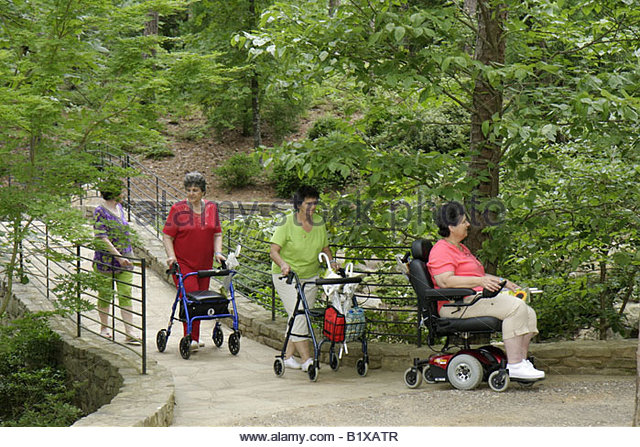 Arkansas Hot Springs Garvan Woodland Gardens woman women group disabled physically impaired accessible electric - Stock Image