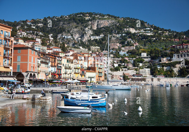 Colourful buildings along waterfront, Villefranche, Alpes-Maritimes, Provence-Alpes-Cote d'Azur, French Riviera, - Stock-Bilder