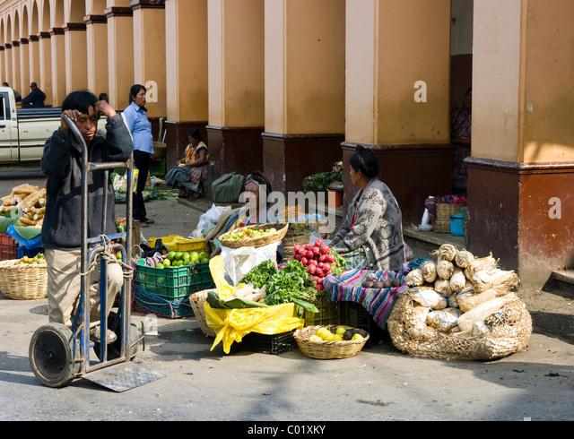san juan sacatepequez women English: woman cleaning zompopos de mayo at the market in san juan  de  mayo en el mercado de san juan sacatepequez, guatemala.