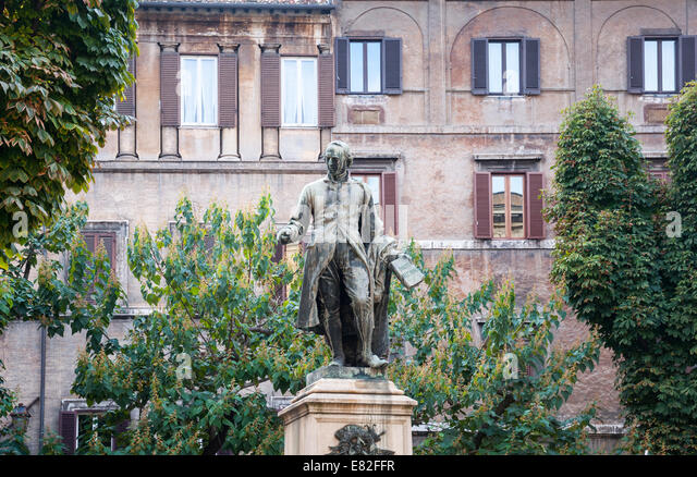 Bronze statue of Nicholas Hospitallers in Piazza Sforza Cesarini in Rome, Italy - Stock Image