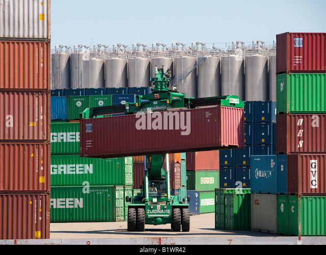 Special large vehicle crane for handling lifting stacking shipping containers Port of Antwerp Flanders Belgium - Stock Image
