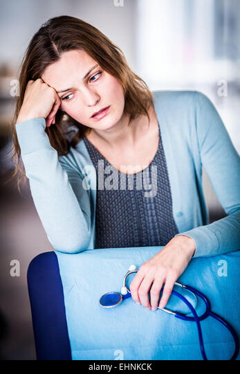 General practitioner looking stressed. - Stock Image