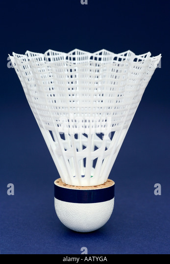 Shuttlecock on Blue Background - Stock Image