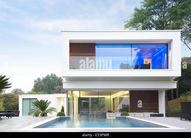 Glowing room of modern house - Stock-Bilder