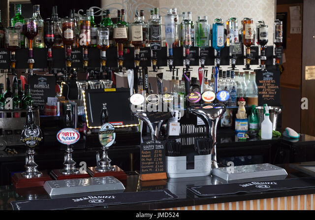 Bar and beer pumps on a local pub, Sowerby Bridge, West Yorkshire - Stock Image