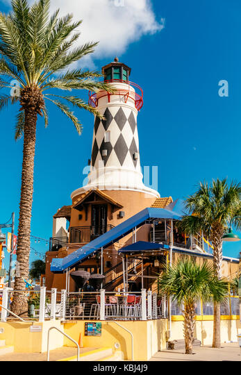 Harry T's restaurant with it's lighthouse feature at Harbor Walk Marina and Village in Destin, Florida, - Stock Image