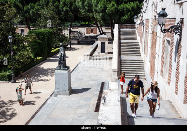 Madrid Spain Europe Spanish Hispanic Centro Jardines de Sabatini Gardens statue stairs man woman couple - Stock Image