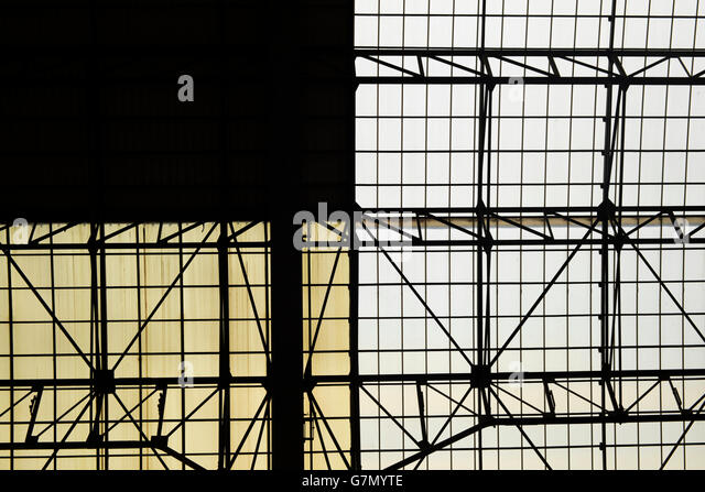 Geometric abstract architecture from the roof of a train station. Photo taken from inside. - Stock Image