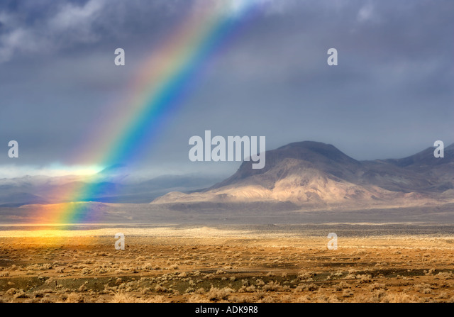 Rainbow with mountains Black Rock Desert National Conservation Area Nevada - Stock-Bilder