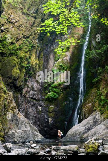 Young girl at base of Niagara Falls - Goldstream Provincial Park - Victoria, Vancouver Island, British Columbia, - Stock Image