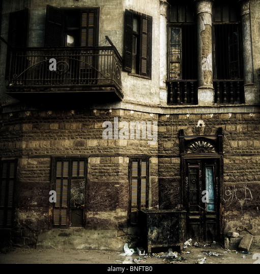 An old decaying colonial building in the town on Luxor Egypt. - Stock Image
