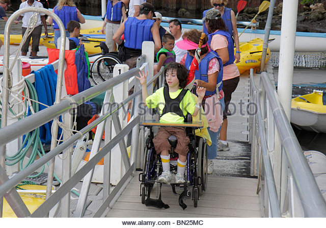 Miami Coconut Grove Florida Shake-a-Leg Miami No Barriers Festival disabled physical disability handicapped boy - Stock Image