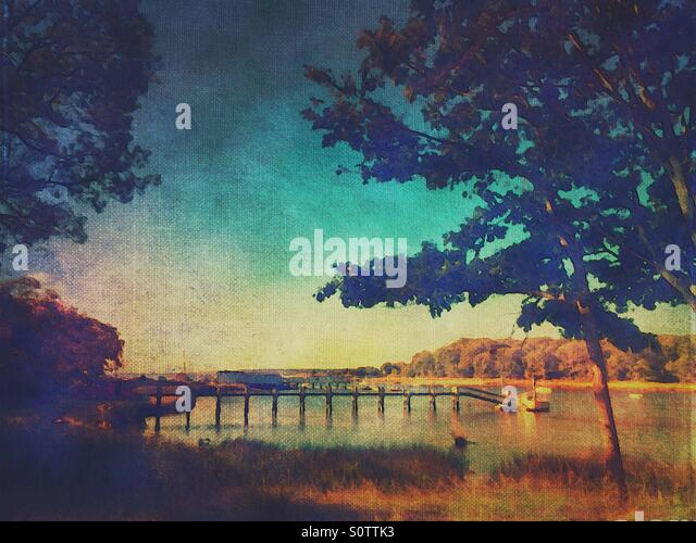 Waterscape Scene With Dock and Trees with Blue Sky - Stock Image