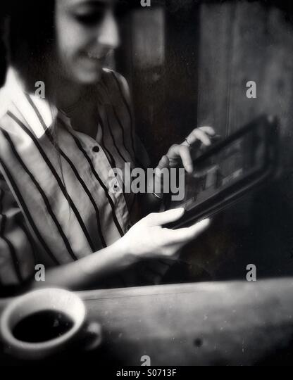 A young woman using a tablet computer - Stock-Bilder