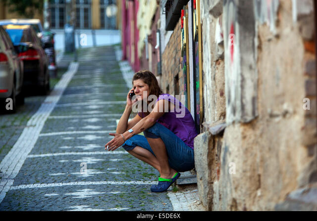 Woman calling on the street, Zizkov Prague Czech - Stock-Bilder
