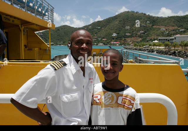 BVI Tortola Road Town Black male ferry captain son boat - Stock Image