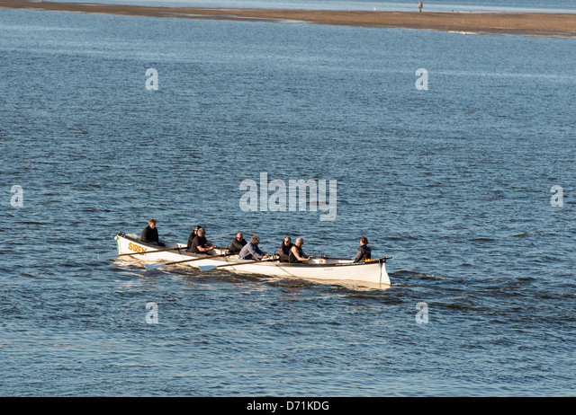 Appledore, North Devon, England. Rowing team rowing in a gig on the River Torridge, - Stock Image