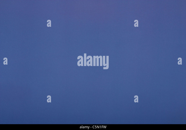 Blue background, paper close-up - Stock Image