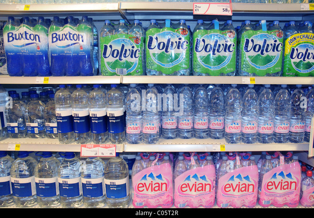 Bottled water on a shelf in a supermarket in England - Stock Image