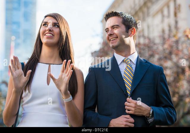 Smart young couple on city street, Toronto, Ontario, Canada - Stock Image