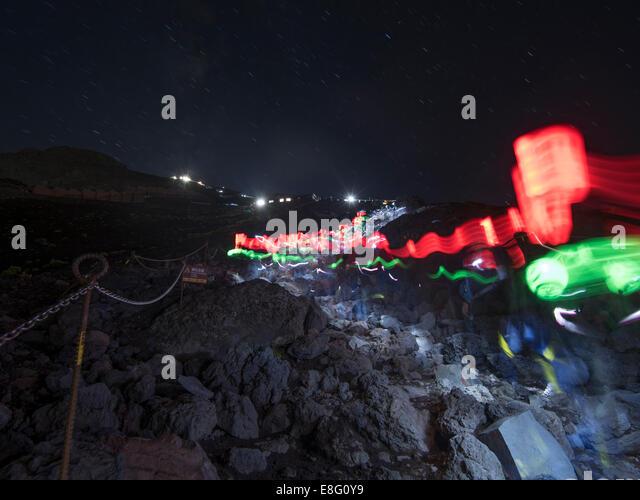 Climbing Mt. Fuji, JAPAN - Lights of hikers on Fuji Subaru Line ( Yoshida Trail ) Night climb - Stock Image