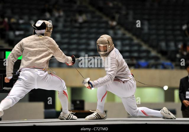 Satoshi Ogawa (JPN) and Kenta Tokunan (JPN) fight during the 64nd All Japan fencing Championships in Tokyo, Japan. - Stock Image