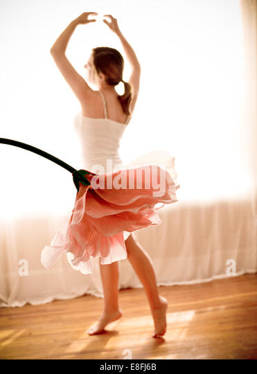 Canada, Quebec, Montreal, Young female Ballerina dancing with Blooming Flower appearing as tutu - Stock Image