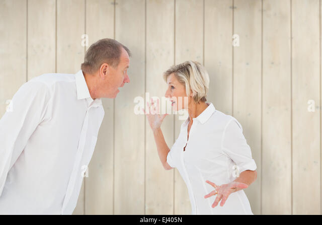 Composite image of angry older couple arguing with each other - Stock Image
