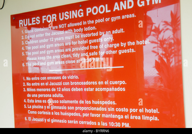 Panama City Panama Bella Vista Via Espana Hotel California sign bilingual Spanish English language pool rules regulation - Stock Image