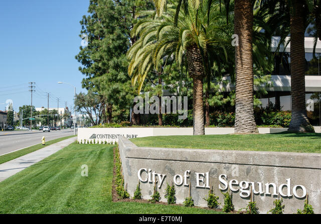 California CA Los Angeles LA L.A. El Segundo Rosecrans Ave sign palm wall landscaping sidewalk street Continental - Stock Image