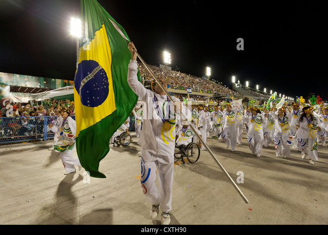 Man with Brazilian Flag while celebrating the Olympics During Carnival Rio de Janeiro Brazil - Stock Image