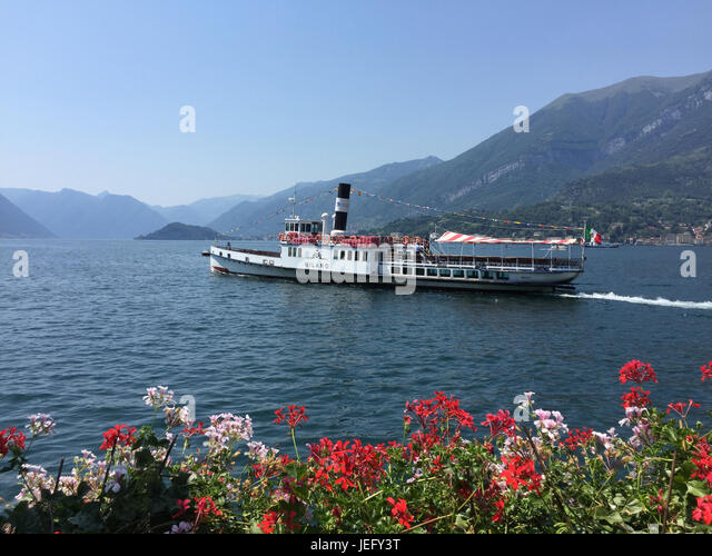 LAKE COMO, Piedmont, Italy, with the vintage 1905 steam ferry 'Milan' heading south past Bellagio.  Photo: - Stock-Bilder