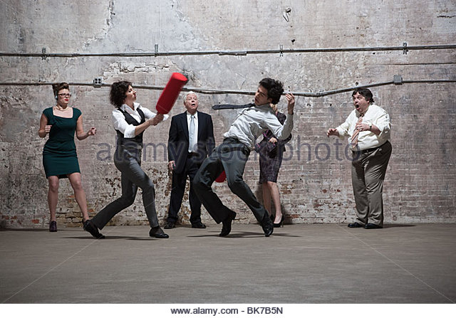 People fighting in warehouse - Stock Image