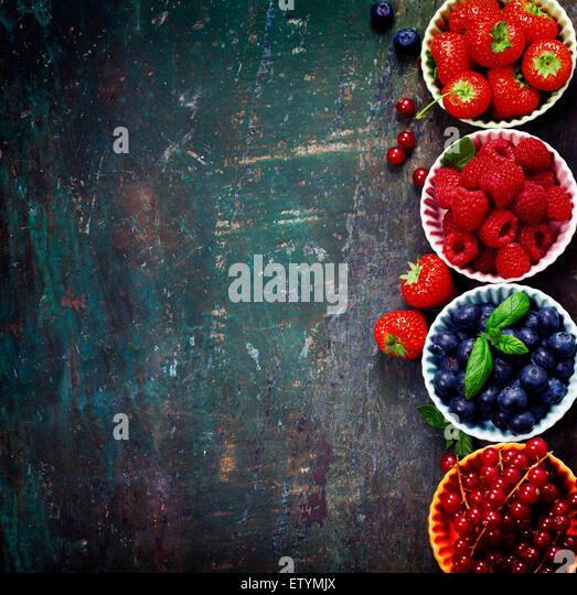 Fresh Berries on Wooden Background. Strawberries, Raspberries and Blueberries. Health, Diet, Gardening, Harvest - Stock Image