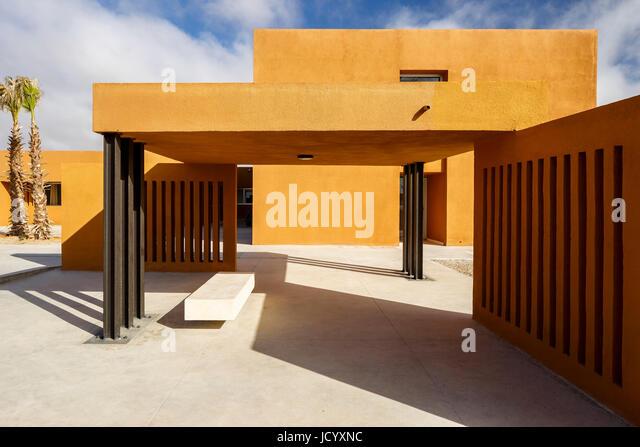 Canopy and ventilation slots. Laayoune Technology School, Laayoune, Morocco. Architect: Saad El Kabbaj, Driss Kettani, - Stock-Bilder